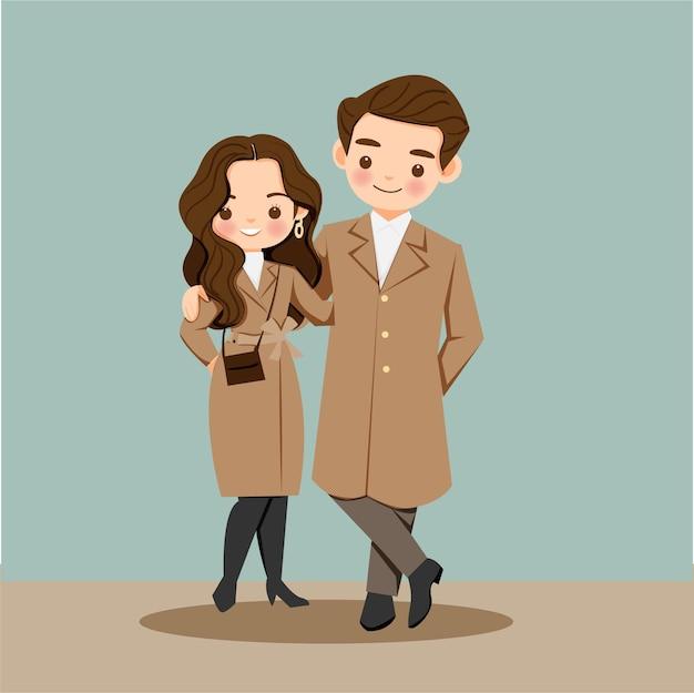 Il personaggio dei cartoni animati delle coppie sveglie in vestito marrone tiene insieme