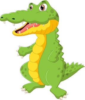 Simpatico cartone animato coccodrillo in piedi e agitando