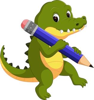 Simpatico coccodrillo che tiene la matita