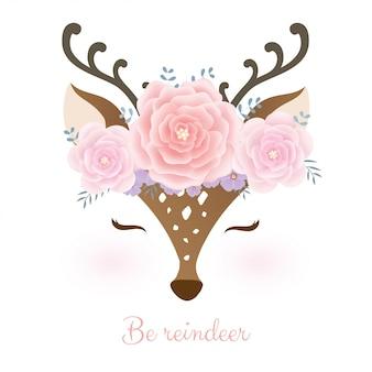 Testa di cervo carina con corona di fiori.
