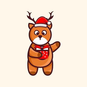 Simpatico cervo con cappello natale e regalo personaggio fumetto illustrazione design