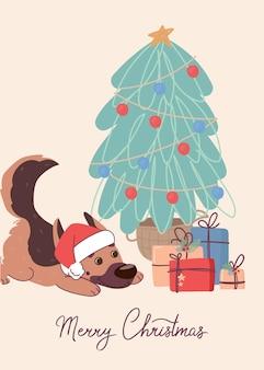 Simpatico cane pastore tedesco sulla cartolina di natale