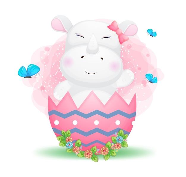 Ragazza sveglia di rinoceronte del bambino di doodle nell'uovo di pasqua decorativo.