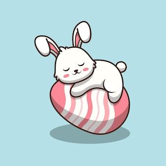 Simpatico coniglietto di pasqua che dorme sulle uova fumetto illustrazione