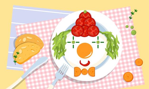 Simpatico pagliaccio commestibile su un piatto, fatto di pomodori, uova fritte, piselli, insalata e carota da genitori amorevoli e creativi per i loro figli. problema alimentare schizzinoso. sfide per i genitori. salute e benessere.