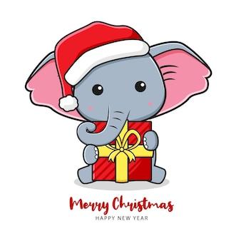 Simpatico elefante con un regalo che saluta buon natale e felice anno nuovo fumetto doodle illustrazione