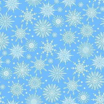 Modello senza cuciture carino festivo stagione invernale con varie icone di fiocchi di neve pastello su sfondo blu