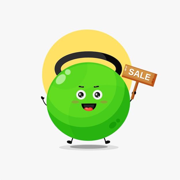 Simpatico personaggio con kettlebell fitness con cartello di vendita