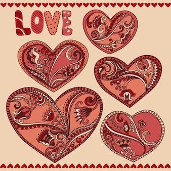 Cuori floreali carini per il design di matrimonio e san valentino.