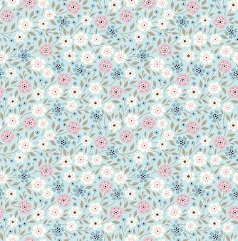 Simpatico motivo floreale nei piccoli fiori. stampa ditsy. sfondo vettoriale senza soluzione di continuità.