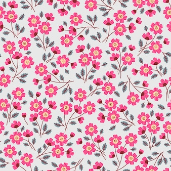 Simpatico motivo floreale nei piccoli fiori rosa. trama senza soluzione di continuità. sfondo grigio chiaro.