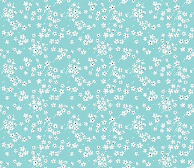 Simpatico motivo floreale nei piccoli fiori bianchi. stampa ditsy. senza soluzione di continuità.