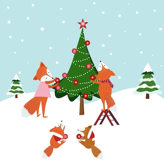 Il fumetto sveglio della famiglia della volpe decora l'albero di natale.