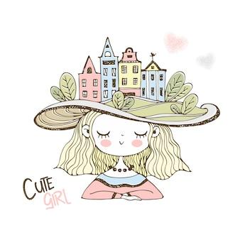Ragazza carina in un cappello con case europee.