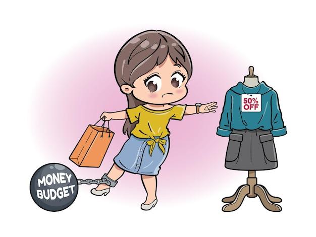 Una ragazza carina trattenuta dal budget in denaro durante lo shopping
