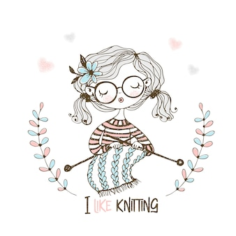 Una ragazza carina lavora a maglia una sciarpa sui suoi ferri da maglia.
