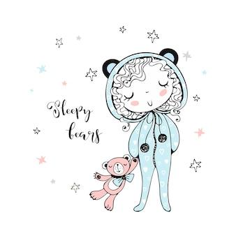 Ragazza carina in pigiama a forma di orsi che va a dormire con un orsacchiotto giocattolo.