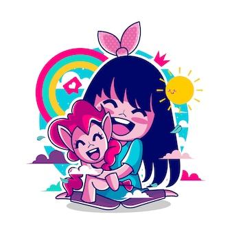 Ragazza carina con bambola pony