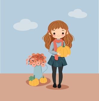 Ragazza carina con zucche per la festa d'autunno