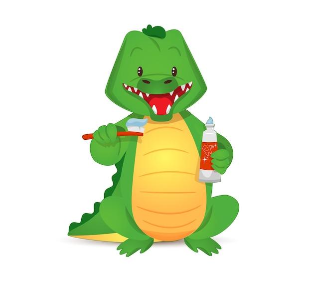 Simpatico coccodrillo verde che si lava i denti tenendo lo spazzolino da denti e il dentifricio nelle zampe