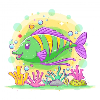 Pesce chirurgo verde carino pone sopra le barriere coralline colorate