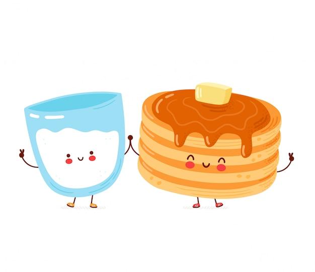 Frittelle divertenti felici sveglie e bicchiere di latte