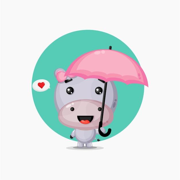 Ippopotamo sveglio che porta un ombrello