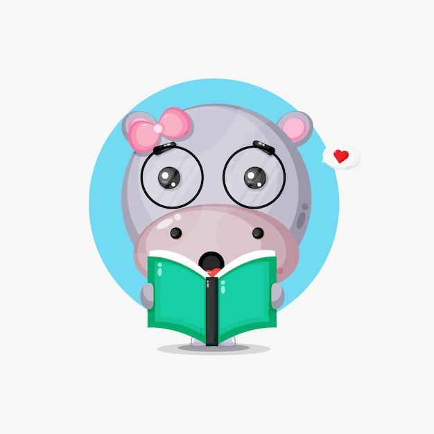 Ippopotamo carino sta leggendo un libro