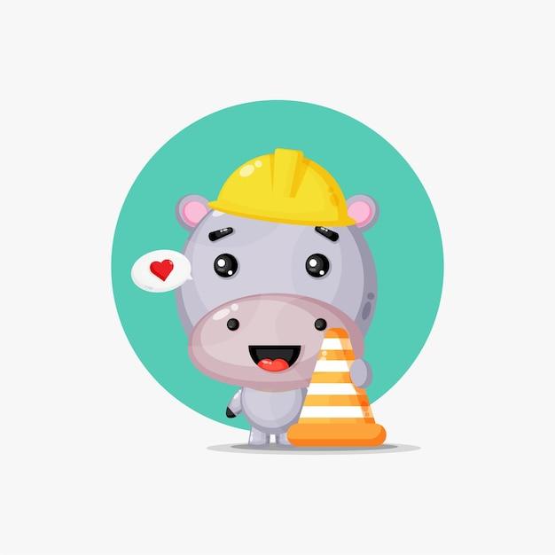 Ippopotamo carino lavora nella costruzione