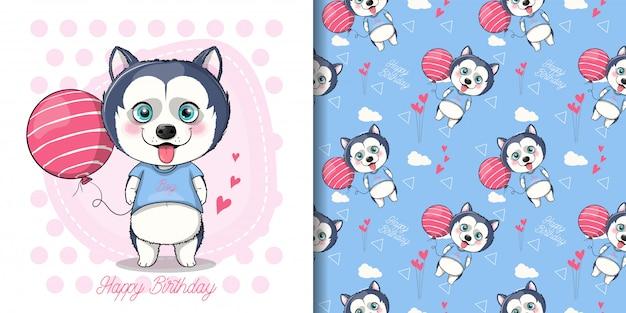 Simpatico cucciolo di husky con palloncino