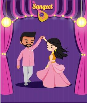Danza di coppia indiana carina nella cerimonia di matrimonio di sangreet