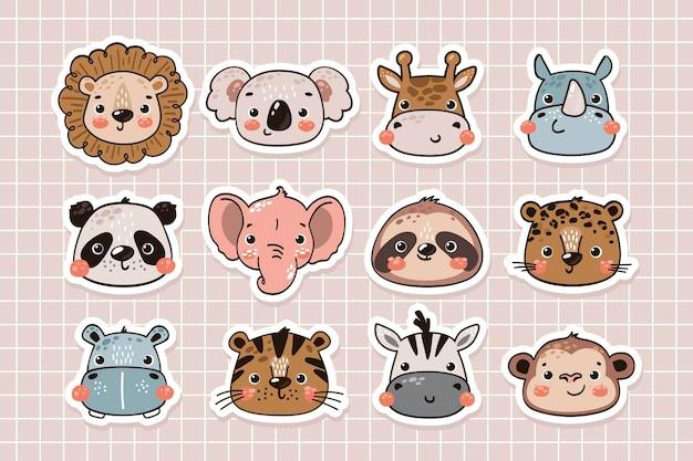 Simpatici animali della giungla facce collezione di adesivi in stile disegnato a mano