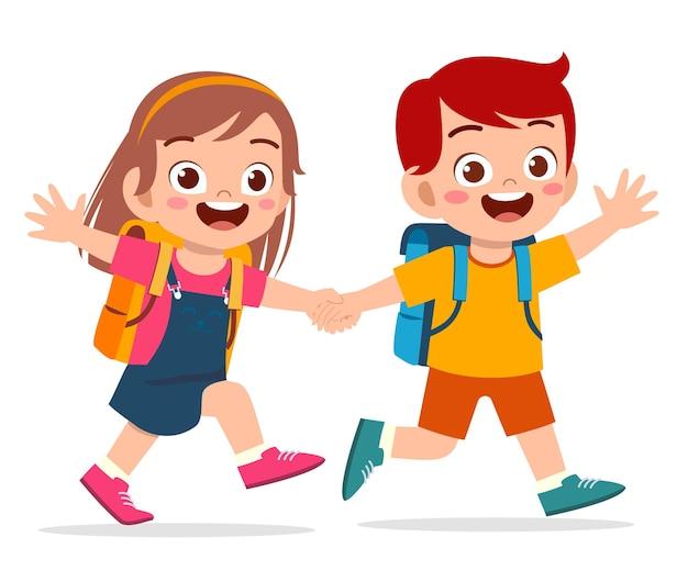Ragazzo sveglio del bambino e ragazza che tengono la mano e vanno a scuola insieme