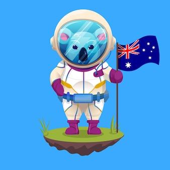 Koala sveglio in costume da astronauta che tiene la bandiera australiana per celebrare la giornata australiana