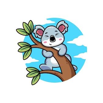 Cartone animato carino koala appeso all'albero