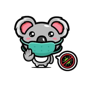 Simpatico koala che indossa una maschera con una posa per fermare il virus