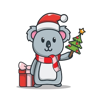 Carino koala con confezione regalo tenendo albero di natale