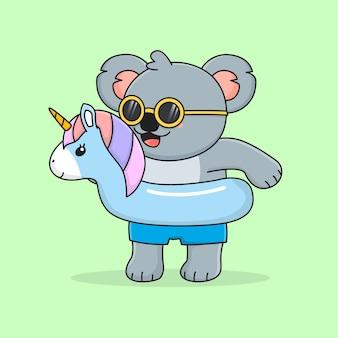 Simpatico koala con anello di nuotata unicorno e occhiali da sole