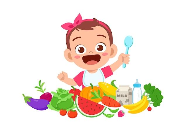 La piccola neonata sveglia mangia frutta e verdura