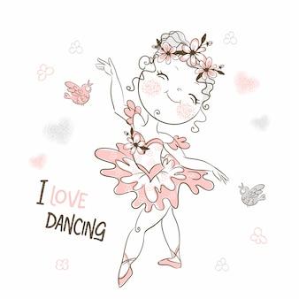 Una piccola ballerina carina in un tutu rosa sta ballando.