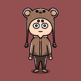 Ragazzino carino che indossa un costume da orso