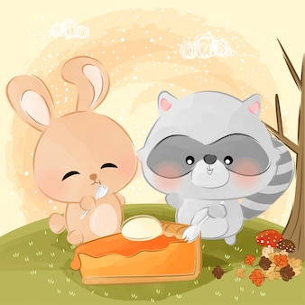 Simpatico coniglietto e procione mangia la torta di zucca