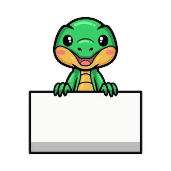 Simpatico cartone animato coccodrillo con segno bianco