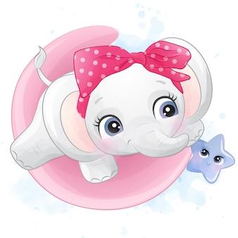 Piccolo elefante sveglio che gioca con una stella