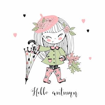 Una bambina carina in un berretto cammina in autunno con un grande ombrello.