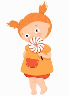 Bambina carina che mangia caramelle