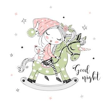 Una bambina carina dorme dolcemente su un cavallo giocattolo di unicorno.