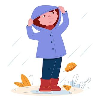 Bambina carina in un impermeabile con un cappuccio in stivali di gomma sotto la pioggia vector