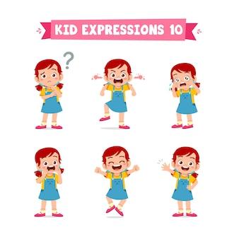 Bambina sveglia del bambino in varie espressioni e insieme di gesto