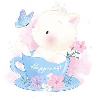 Piccolo gattino sveglio dentro la tazza che gioca con la farfalla Vettore Premium